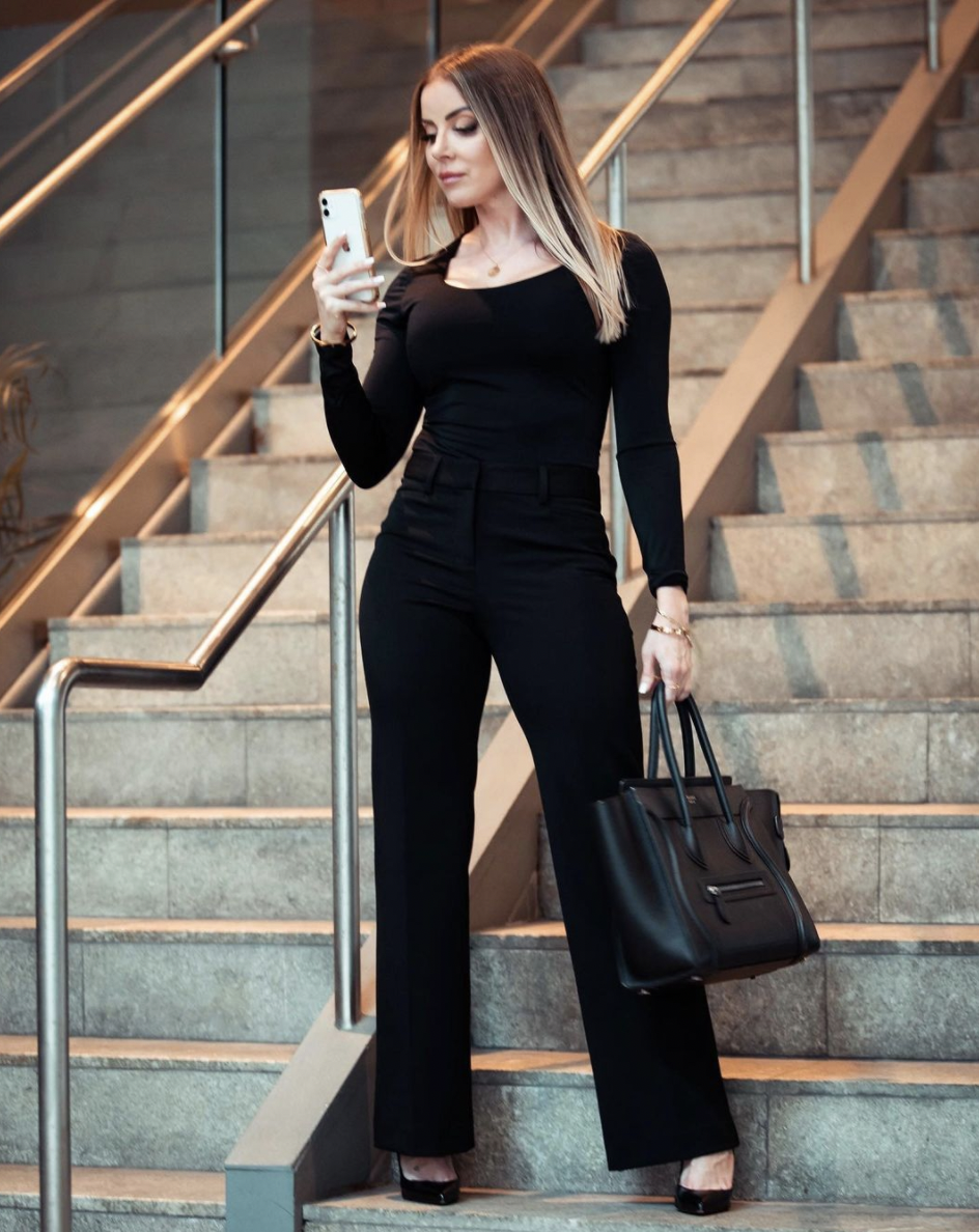 Geisha Garcia in a black suit
